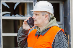 Construction inspector near building with broken window Stock Photography