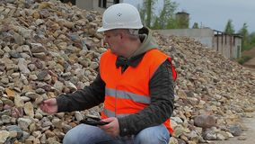 Construction inspector near the pile of crushed stone stock video