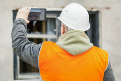 Construction inspector with tablet PC near building Stock Image