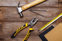 Construction instruments on wooden table Royalty Free Stock Photo