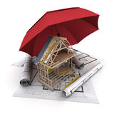 Construction insurance. An umbrella protecting a house under construction Royalty Free Stock Images