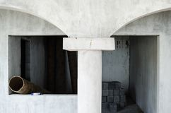 Construction of the interior of a house made of gray cement started, unfinished construction of gray cement royalty free stock photo