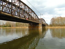 Construction of iron bridge across the river in deep forests in the midle of Europe Stock Photos