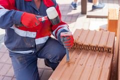 Construction labor use a chisel to break bricks. Construction labor use a chisel to break bricks royalty free stock photo