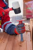 Construction labor use a chisel to break bricks. Construction labor use a chisel to break bricks royalty free stock image
