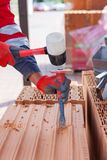 Construction labor use a chisel to break bricks. Construction labor use a chisel to break bricks royalty free stock photography