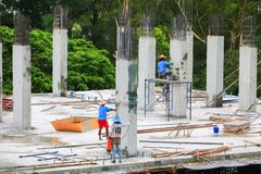 Construction laborer team working on high ground building commercial  in site workplace. Construction laborer team working on high ground building commercial in Royalty Free Stock Photos