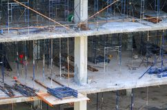 Construction laborer team working on high ground building commercial  in site workplace.  Royalty Free Stock Photos