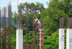 Construction laborer team working on high ground building commercial  in site workplace. Construction laborer team working on high ground building commercial in Stock Image