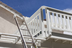 Construction Ladder Leaning on White House Deck Stock Image