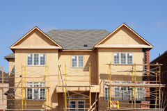 Construction of a large home. Against a blue sky royalty free stock image
