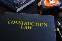 Construction law. Book and glasses. Construction law. Book and glasses on a wood royalty free stock photos