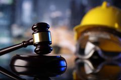Construction law. Law theme. Construction law`s symbols  - helmet and gavel. Constuction background Royalty Free Stock Photo