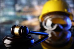 Construction law. Law theme. Construction law`s symbols  - helmet and gavel. Constuction background Stock Photography