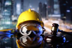 Construction law. Law theme. Construction law`s symbols  - helmet and gavel. Constuction background Royalty Free Stock Photos