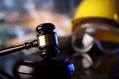 Construction law. Law theme. Construction law`s symbols  - helmet and gavel. Constuction background Royalty Free Stock Photography