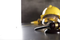 Construction law. Law theme. Construction law`s symbols - helmet and gavel. Stone table Stock Photo