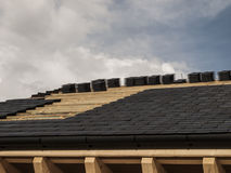 Construction, laying ceramic tile roof Stock Photo