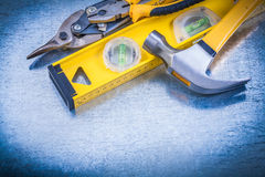 Construction level claw hammer tin snips on Stock Image