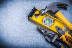 Construction level claw hammer tin snips pliers on Royalty Free Stock Photos