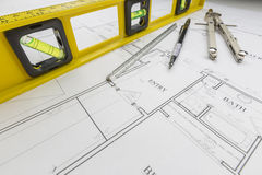 Construction Level, Pencil, Ruler and Compass Resting on House P Stock Photos