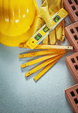 Construction level red bricks building helmet protective gloves Royalty Free Stock Images