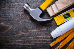 Construction level rolled up blueprint claw hammer Stock Images