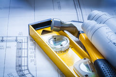 Construction level some building sketches and claw Royalty Free Stock Photography