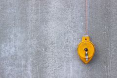 The construction level is yellow. Concrete wall. Tools for building a house. stock photo