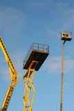 Construction lift 2. Construction platform on the blue sky Royalty Free Stock Photo