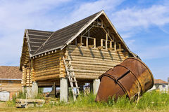 Construction of log house in the village Stock Photo