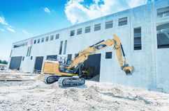 Construction machinery on buildings site against blue sky Stock Image