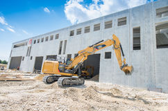 Construction machinery on buildings site against blue sky Stock Photography