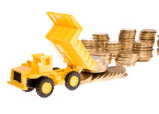 Construction machinery with coins Royalty Free Stock Photo