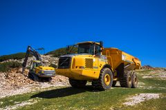 Construction machinery for crushing stone Stock Photos