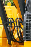 Construction machinery. Detailed view of heavy vehicle, of the building dozer or other construction machinery Stock Image