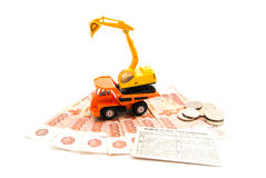 Construction machinery, driving license and coins Stock Images