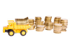 Construction machinery over a lot of golden coins Stock Image