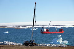 Construction machinery and ship in Arctic Stock Images