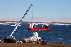 Construction machinery and ship in Arctic Royalty Free Stock Photography