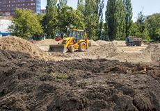 Construction machinery on site. Construction machinery on construction site in the city on summer day Stock Photo