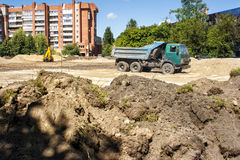 Construction machinery on site. Construction machinery on construction site in the city on summer day Stock Photography