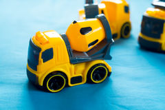Construction machinery toy. Construction machinery plastic yellow toy on blue bed Royalty Free Stock Image