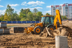 Construction machinery - tractor mover on building site Royalty Free Stock Images