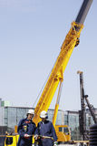 Construction machinery and workers Stock Photo