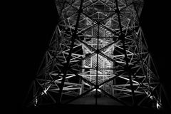 Construction made of metal and steel. Metallic truss, girder and beam as structure of building. Architecture is lit by light at night royalty free stock photography