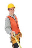 Construction Man. A handsome contruction worker with tape measure isolated over white stock image