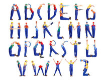 Construction man alphabet. Alphabet formed from young people wearing industrial uniforms and helmets posing with various tools and accessories stock image