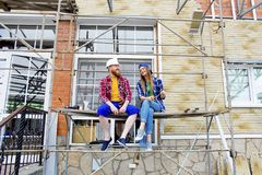 Couple building a house. Construction. Man and his wife building a house Royalty Free Stock Photo
