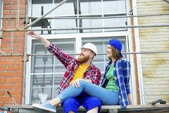 Couple building a house. Construction. Man and his wife building a house Stock Images